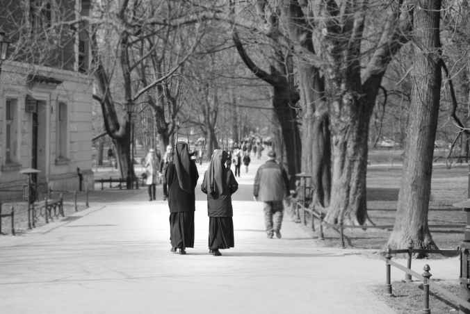grayscale photo of two nuns