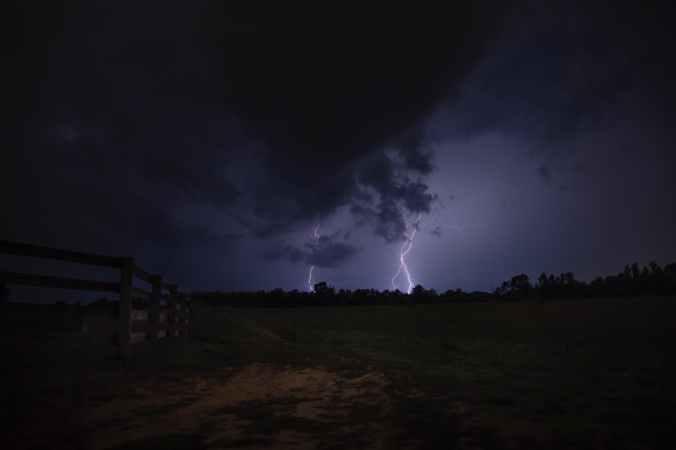 lightning strike the ground during night time