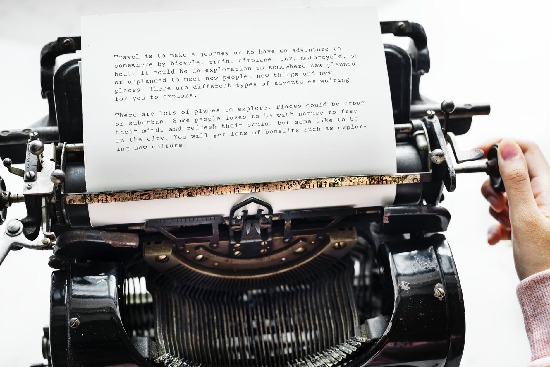 person holding black typewriter